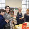 Ian LeBlanc and mother Cindi LeBlanc buying a Raffle ticket from Karylle Wetzler and Judy Matejka, Library volunteers.
