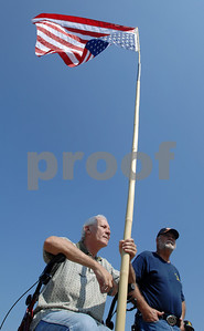 "Jerry B. Willis (left) of Pelatchie displays an inverted American flag as he and Larry Martin of Smith County participate in a Mississippi Tea Party Rally Saturday morning at the Mississippi Fairgrounds in Jackson.  Willis says that he is displaying the upside-down flag in accordance  with a section of the U.S. Flag Code, which states, ""The flag should never be displayed with the union down, except as a signal of dire distress in instances of extreme danger to life or property."""