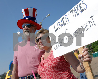 Petter Sittler of Jackson and Beverly Herbert of Madison listen to speakers at a Mississippi Tea Party Rally Saturday morning at the Mississippi Fairgrounds in Jackson.