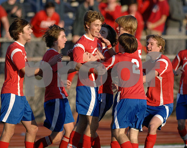 Jackson Prep's Jason Campbell (center) is congratulated by teammages after scoring an equalizing goal in the first half of Saturday's MAIS divisional semifinal game against Jackson Academy.