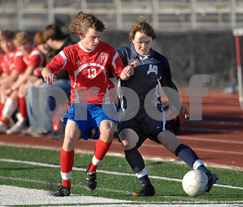 Jackson Prep's Robert Mounger (left) and Jackson Academy's Jay Shell battle for the ball during the first half of Saturday's MAIS divisional semifinal game at Jackson Prep.