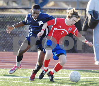 Jackson Academy's A.J. Arnold (left) and Jackson Prep's James Coggin battle for the ball during the first half of Saturday's MAIS divisional semifinal game at Jackson Prep.