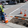 TIM JEAN/Staff photo<br />   <br /> Marc Fournier, Deputy Director of Public Works / Highway Superintendent talks about how they doubled the size of an existing tree pit and will install CU Structural Soil developed by Cornell University before planting a Red Maple tree along Main Street during an Arbor day celebration.  4/27/18