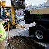 TIM JEAN/Staff photo<br />   <br /> Members of Andover's Department of Municipal Services used shovels then used a excavator to remove old dirt before installing CU Structural Soil developed by Cornell University before planting a Red Maple tree along Main Street during an Arbor day celebration.  4/27/18