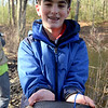TIM JEAN/Staff photo<br />   <br /> Spencer Nelson, 12, of Andover, shows off a trout he caught during the Andover Sportsmen's Club annual fishing derby at Sudden Pond in Harold Parker State Forest.  4/21/18