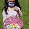 TIM JEAN/Staff photo<br /> <br /> Shruti Patel, 7, of Andover, shows off her bounty of eggs she gathered during an egg hunt at Andover's Recreation Park. Participants were given a goody bag with special crafts to be completed at home and also photos taken with the Easter Bunny afterwards.  4/3/21