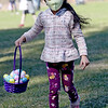 TIM JEAN/Staff photo<br /> <br /> Anaya Sanghvi, 5, of Andover, searches for eggs during an egg hunt at Andover's Recreation Park. Participants were given a goody bag with special crafts to be completed at home and also photos taken with the Easter Bunny afterwards.  4/3/21
