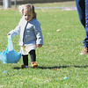 TIM JEAN/Staff photo<br /> <br /> Emilie Mancinelli, 16-months old, of Andover, looks for eggs during an egg hunt at Andover's Recreation Park. Participants were given a goody bag with special crafts to be completed at home and also photos taken with the Easter Bunny afterwards.  4/3/21