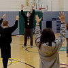 TIM JEAN/Staff photo<br /> Physical Education Teacher John Rex, center, instructs  students during gym class at Bancroft Elementary School in Andover. Elementary students are back full-time for in-school learning starting this week.       4/6/21