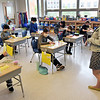 TIM JEAN/Staff photo<br /> Third grade teacher Maryrose Tingle, right, goes over a lesson at Bancroft Elementary School in Andover. Andover's elementary students are back full-time for in-school learning starting this week.       4/6/21