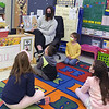 TIM JEAN/Staff photo<br /> Kindergarten teacher Meghan Leary reads a book to her students at Bancroft Elementary School in Andover. Elementary students are back full-time for in-school learning starting this week.       4/6/21