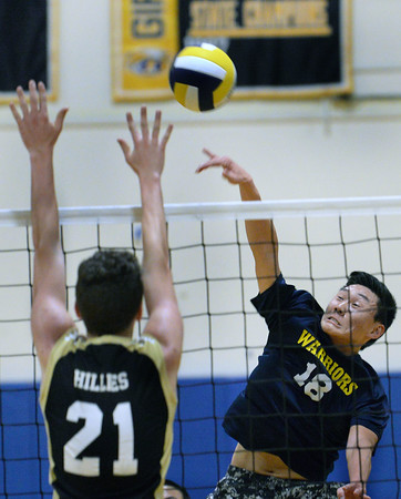 CARL RUSSO/staff photo. Andover's Timothy Liu spikes the ball as Haverhill's Kevin Connors defends. Andover against Haverhill in volleyball action Monday afternoon. 4/30/2018