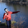 TIM JEAN/Staff photo<br />   <br /> DJ Repetto, 13, of Andover, checks the lure on his line, during the Andover Sportsmen's Club annual fishing derby at Sudden Pond in Harold Parker State Forest.  4/21/18