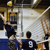 CARL RUSSO/staff photo. Andover's captain, Steven Crowley prepares to spike the ball. Andover against Haverhill in volleyball action Monday afternoon. 4/30/2018