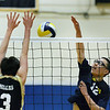 CARL RUSSO/staff photo. Andover's captain, Yanchen Zhan spikes the ball as Haverhill's Cooper Gibbs defends.  Andover against Haverhill in volleyball action Monday afternoon. 4/30/2018