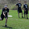 TIM JEAN/Staff photo<br />   <br /> Andover Ultimate's  Andrew Halloran, left, reaches out to make a catch as his teammates in back, Quard Johnson (35) and Tate Jodoin (32) wait for their turn in-between a match during the 17th annual Invitational, held at the Greater Lawrence Tech School in Andover.     4/28/18