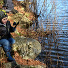 TIM JEAN/Staff photo<br />   <br /> Nathan Cream, 4, of Peabody finds a comfortable rock to sit on while waiting for the fish to bite during the Andover Sportsmen's Club annual fishing derby at Sudden Pond in Harold Parker State Forest.  4/21/18