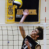 CARL RUSSO/staff photo. Haverhill's Spencer Dellea spikes the ball. Andover against Haverhill in volleyball action Monday afternoon. 4/30/2018