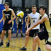 CARL RUSSO/staff photo. Haverhill's Connor Buscema returns the serve. Andover against Haverhill in volleyball action Monday afternoon. 4/30/2018