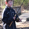TIM JEAN/Staff photo<br />   <br /> Will Rolander, 10, of North Andover, slowly reels in his line while waiting for the fish to bite during the Andover Sportsmen's Club annual fishing derby at Sudden Pond in Harold Parker State Forest.  4/21/18