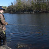 TIM JEAN/Staff photo<br />   <br /> Josh Lister, 11, of North Andover, reels in his line during the Andover Sportsmen's Club annual fishing derby at Sudden Pond in Harold Parker State Forest.  4/21/18