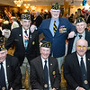 CARL RUSSO/Staff photo. Andover veterans from American Legion, Post 8 attend the dinner. Seated from left: Fran Rittershaus, Navy veteran; George Walsh, Air Force and Joe Hey, Army. Standing: Rich Guilmette, Navy; John Doherty, Army and Al Dusey, Army Air Corp. W.W. II veteran. He few 25 missions over Europe in a B-17. The Run For The Troops 7th. annual pre-race dinner was held last Friday night. Over 100 veterans, race runners and guest attended the dinner and silent auction held at the Andover Country Club. The event and Sunday's race benefites Homes For Our Troops, a non-profit national organization that builds homes for veterans who are disabled, injured or otherwise unable to live independently. The organization, completely through volunteer efforts, builds custom-designed homes to fit the needs of military personnel. 4/20/2018