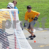 RYAN HUTTON/ Staff photo<br /> Nico Welch, 11, moves to grab the ball behind his team's net as Wood Hill Middle School faces off with Doherty Middle at the Andover Hockey Association street hockey tournament at Merrimack College on Sunday.