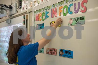 AMANDA SABGA/Staff photo   South Elementary school first grade teacher Joellen Zappas decorates her class in preparation of the start of school.   8/20/18
