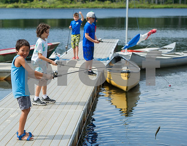 AMANDA SABGA/Staff photo   Gabe Shneer, 7, reacts to catching a fish as Mass. Wildlife hosts as fishing workshop at Pomps Pond in Andover.   8/20/18