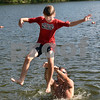 CARL RUSSO/staff photo. TOWNSMAN: Ethan Maravelias, 11 is tossed into the water by his father Jason while playing at Pomps Pond Friday afternoon. Andover residents spend the day at Pomps Pond seeking relief from the heat.  8/03/2018 8