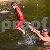CARL RUSSO/staff photo. TOWNSMAN:  Alexander Maravelias, 7 is tossed into the water by his father  Jason while playing at Pomps Pond Friday afternoon. Andover residents spend the day at Pomps Pond seeking relief from the heat.  8/03/2018