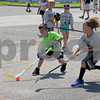 RYAN HUTTON/ Staff photo<br /> Austin Napolitano, 7, left, carries the ball down court toward the West Elm Elementary net as West Elm and Bancroft Elementary go head to head at the Andover Hockey Association street hockey tournament at Merrimack College on Sunday.