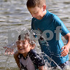 CARL RUSSO/staff photo. TOWNSMAN:  Nathen Chapper, 8, splashes his friend James Bailey, 8, while they play at Pomps Pond Friday afternoon.  Andover residents spend the day at Pomps Pond seeking relief from the heat.  8/03/2018