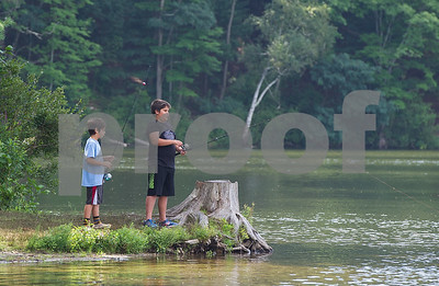 AMANDA SABGA/Staff photo   Mir, 8, and Zain Durrani, 12, try to catch fish as Mass. Wildlife hosts as fishing workshop at Pomps Pond in Andover.   8/20/18