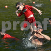 CARL RUSSO/staff photo. TOWNSMAN: Alexander Maravelias, 7 is tossed into the water by his father Jason as his brother Ethan 11, swims pass them. The family was enjoying the day at Pomps Pond late Friday afternoon. Andover residents spend the day at Pomps Pond seeking relief from the heat.  8/03/2018