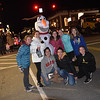 TIM JEAN/Staff photo<br /> <br /> Teenages gather around Olaf the Snowman for a photo during Andover's annual Holiday Happenings.   12/7/18