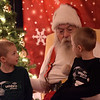 TIM JEAN/Staff photo<br /> <br /> Twin brothers Ethan and Aaron Scott, 5, of Andover, talk with Santa in the Old Town Hall, during Andover's annual Holiday Happenings.   12/7/18