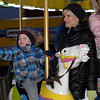 TIM JEAN/Staff photo<br /> <br /> Brett Haggerty, 3, of Andover, waves from the carousel ride  in The Park, while riding it with his grandmother Joan Devlin, during Andover's annual Holiday Happenings.   12/7/18