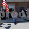 TIM JEAN/Staff photo<br /> <br /> Brides are treated like royalty as they enter the new shop as Andover's American Legion Post 8 honor guard welcome them during a grand opening of Brides Across America new full services location on North Main St., Andover.     7/12/18