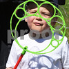 BRYAN EATON/Staff photo. Max Traub, 3, of Andover does his best to get bubbles out of the wand at Farm Day in the Park.