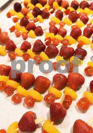 BRYAN EATON/Staff photo. Andover Country Club chef Elaine Chirichiello's strawberry, Mandarin orange and grape tomato sticks glazed with white rum, Grand Marnier, strawberry liqueur with brown sugar and butter.