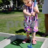 BRYAN EATON/Staff photo. Madeline Carucci, 2, of Andover takes aim on the putting green.