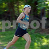 RYAN HUTTON/ Staff photo<br /> North Andover native Alex Kramer rounds the final turn before coming in first at the Ironstone Derby 5K at Ironstone Farm on Sunday morning.