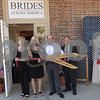 TIM JEAN/Staff photo<br /> <br /> Cutting a ceremonially ribbon are from left, Terry Brumley, mother of Heidi Janson, owner Tulle Bridal and founder of Brides Across America, Alex Vispoli, Andover Selectman, and Wil Carpenter, VP, Merrimack Valley Chamber of Commerce during a grand opening of Brides Across America new full services location on North Main St., Andover.     7/12/18