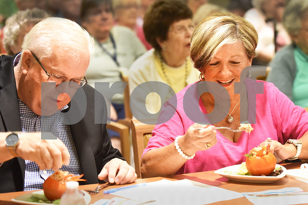 BRYAN EATON/Staff photo. Judges John Felci, director of marketing for Patriot Ambulance, and Diane Coletta of Haverhill sample the lobster-stuffed tomatoes.