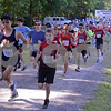 RYAN HUTTON/ Staff photo<br /> Runners take off from the starting line of the Ironstone Derby 5K at Ironstone Farm in Andover on Sunday morning.