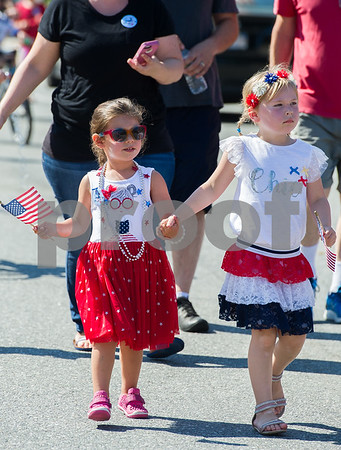 AMANDA SABGA/Staff photo<br /> <br /> Mariella DiPrimio, 4, of North Andover, and Isla North, 5, of Andover walk hand in hand down Main Street in the Horribles Parade during Andover's Fourth of July celebrations.<br /> <br /> 7/4/18