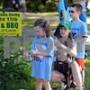 RYAN HUTTON/ Staff photo<br /> Rachel Burke, center, helps her daughter Avery, 5, put on her bib while her sone Owen, 7, right, waits for the Ironstone Derby to start at Ironstone Farm on Sunday morning.