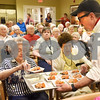 BRYAN EATON/Staff photo. Jim Arhelger, director of culinary services at Atria Marland Place hands out samples to residents.