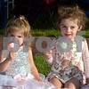 CARL RUSSO/staff photo. TOWNSMAN:  Isabelle Fuller, 2 and her sister Sabrina, 3 enjoy their ice-cream.  A 60s Invasion, a classic rock group playing music from the 60's and 70's played the first free summer concert at the Park Wednesday night. 7/11/2018